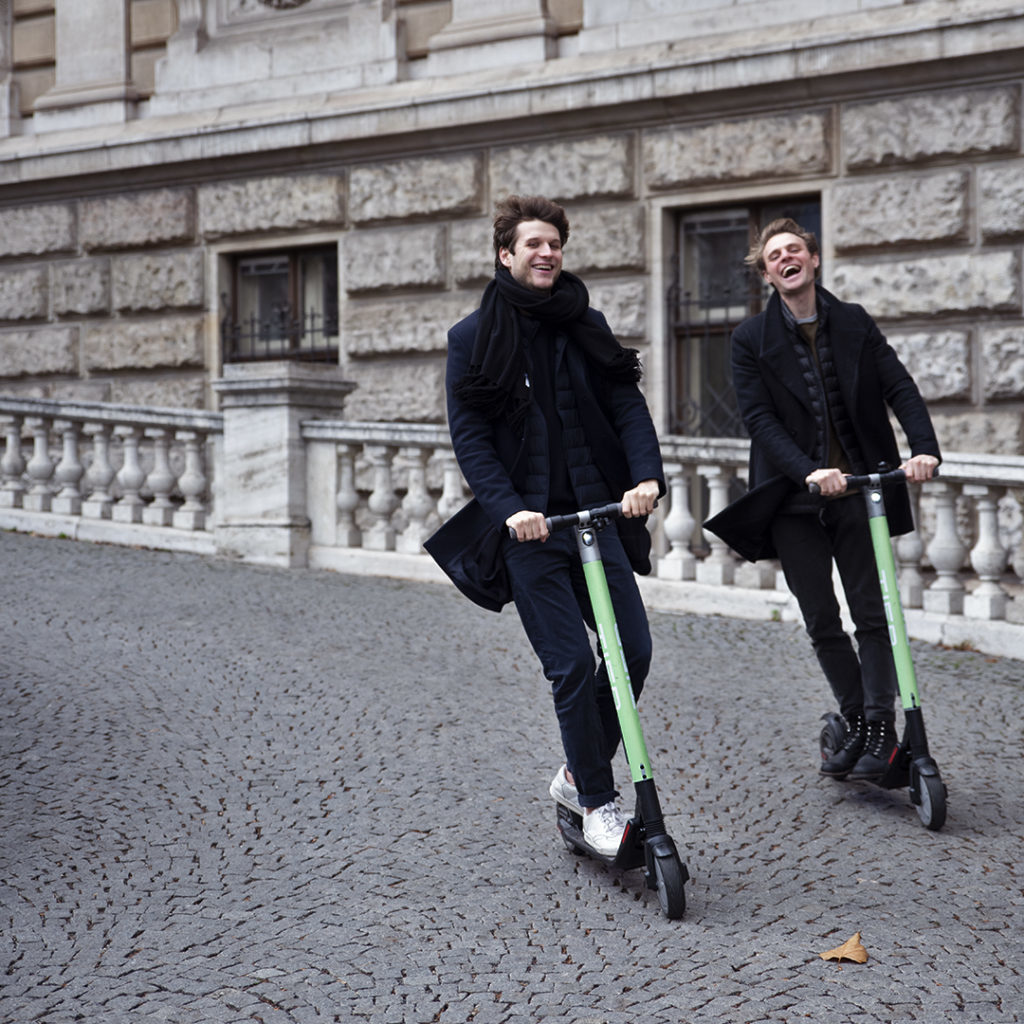 picture of two guys on e-scooters