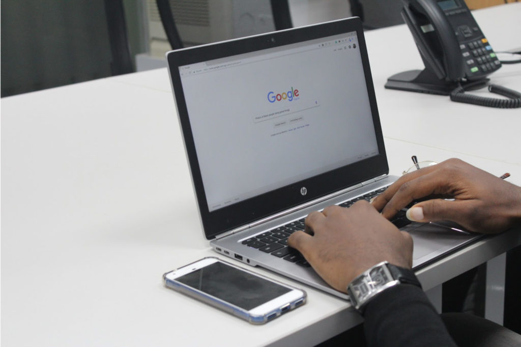 Laptop showing google search